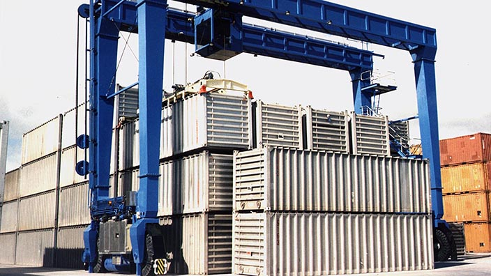 Isoloader Rubber Tired Gantries (RTG) provide cost-effective high density containeried surge capacity for storage of chemicals.