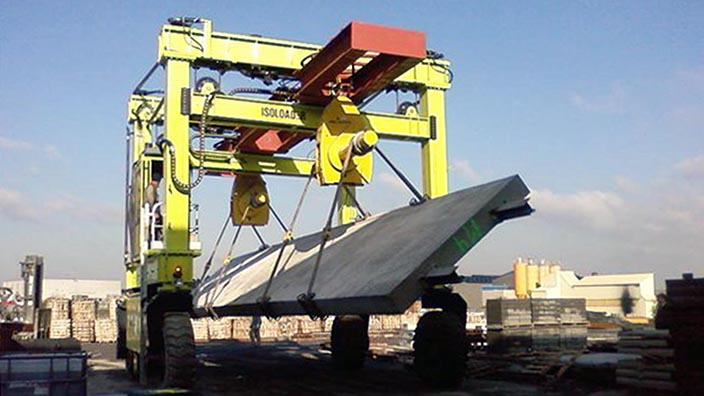 Isoloader Straddle Carriers and Rubber Tyred Gantries (RTGs) can manipulate as well as lift and transport heavy loads, including turning precast concrete segments upside down.